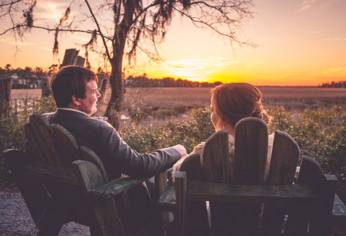 Bride and Groom Relaxing by the Marsh