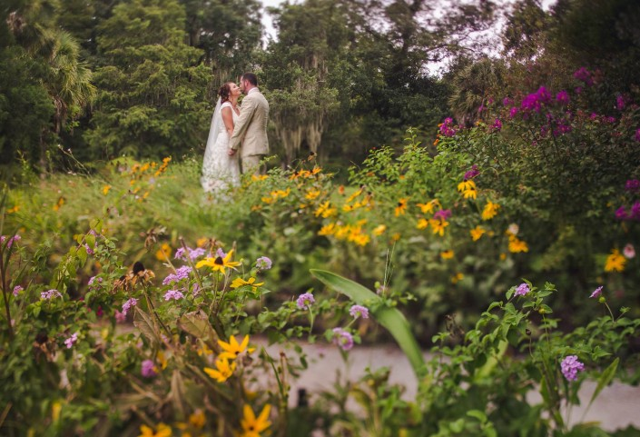 Flower field with bride and groom