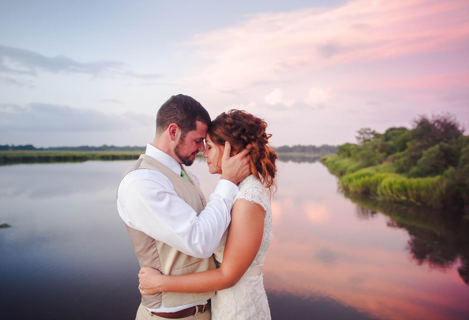 River Sunset with bride and groom wedding portrait