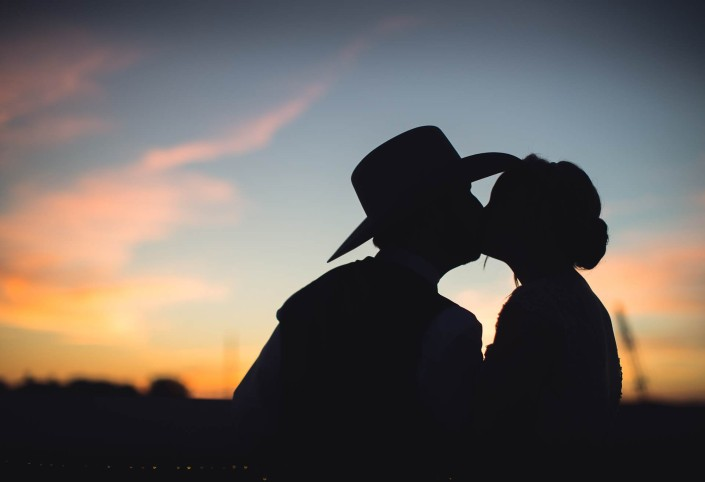 cowboyhat sunset portrait bride and groom