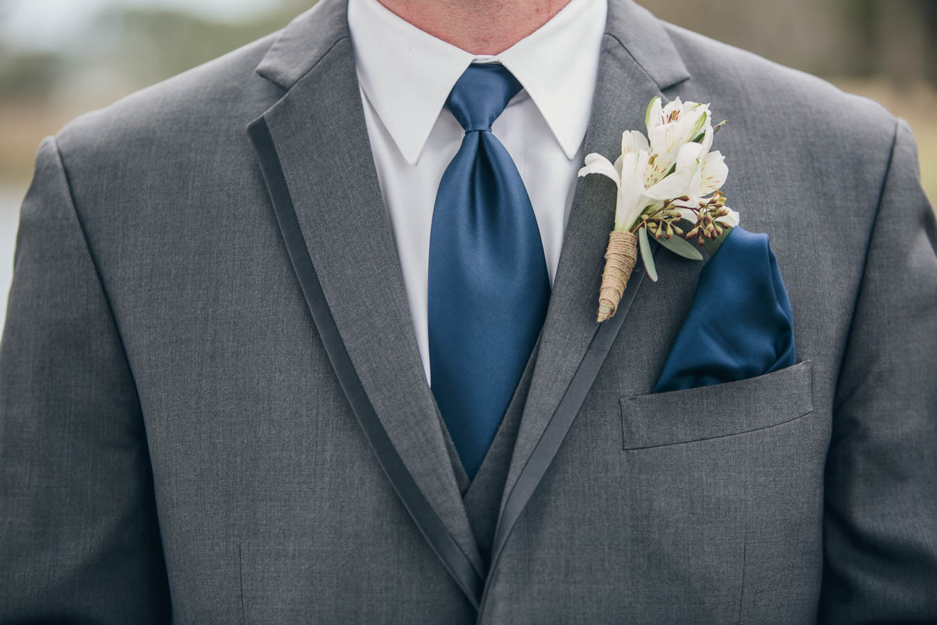 Boutonniere, tie and handkerchief