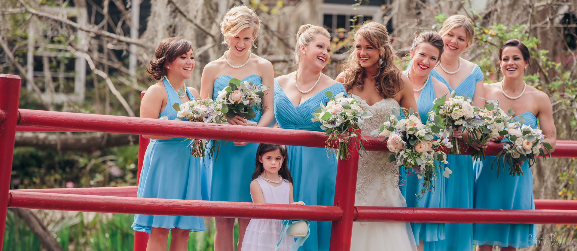 Bride with Bridesmaids on Red Bridge