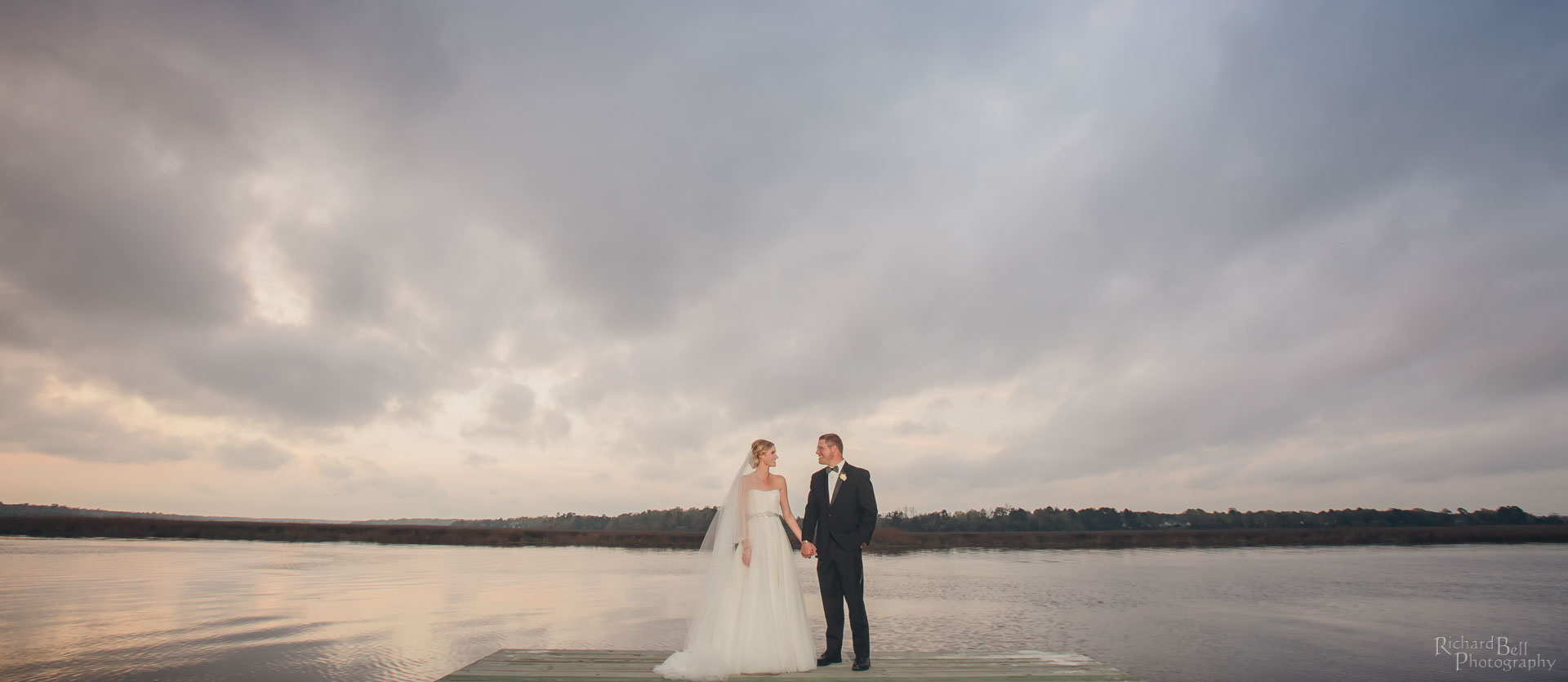 Bride and Groom on Dock at Magnolia