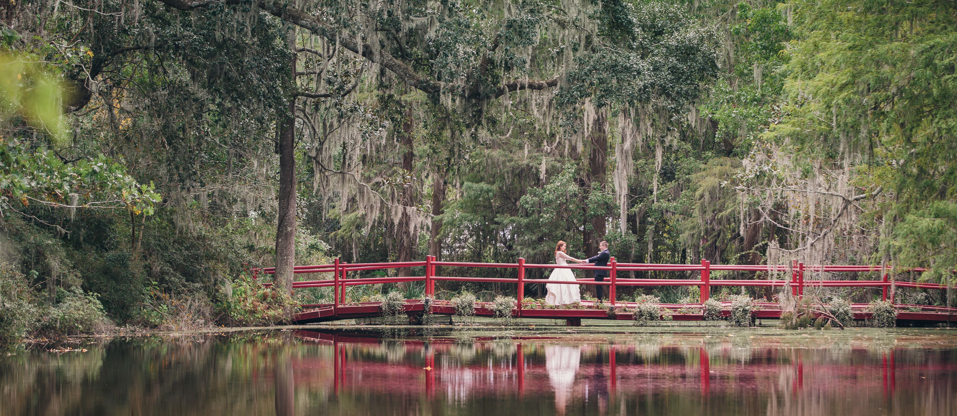 red-bridge-with-bride-and-groom